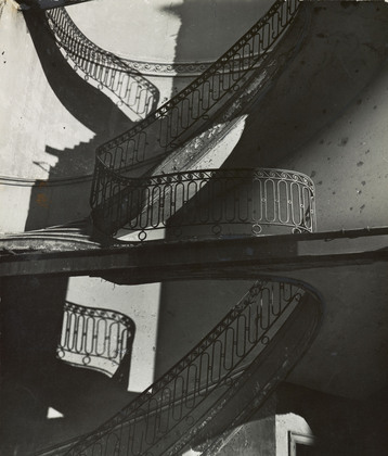 "Bill Brandt. Bombed Regency Staircase, Upper Brook Street, Mayfair. c. 1942. Gelatin silver print, 9 x 7 5/8"" (22.8 x 19.4 cm)."
