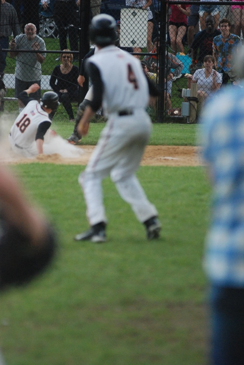 Ben Porter scores the winning run (photo Robert  Birnbaum)