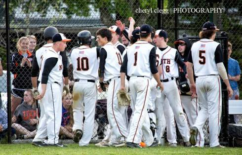 Newton North Tigers Baseball squad celebrates 14th inning win vs Catholic Memorial (photo: Cheryl Clegg)