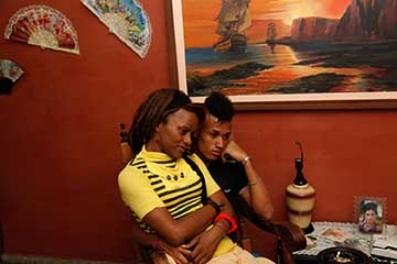 From Trans Cuba-Nomi and Miguel, partners, watching television at Malu's apartment